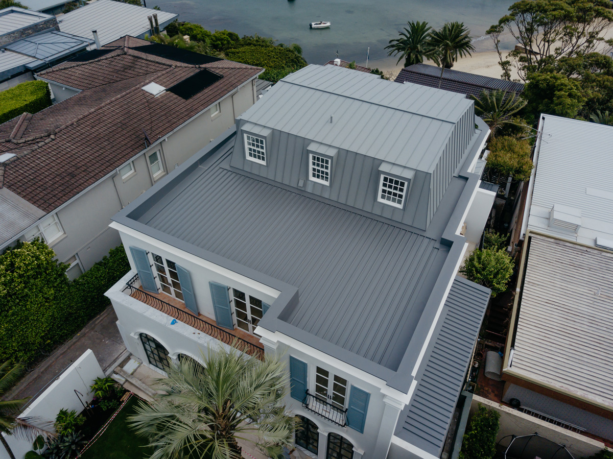 Aluminium stand seam roofing and wall cladding+ Colorbond Klip-lok roofing.